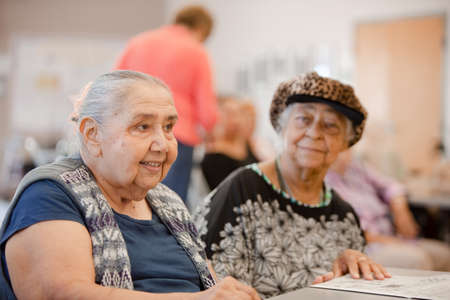 Two happy women in a senior activity enter