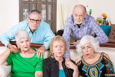 Five upset senior friends reacting in a negative way