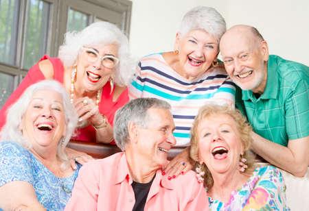Six senior friends laughing and having fun