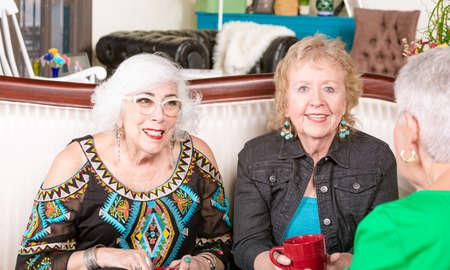 Three senior women having a coffee or tea together