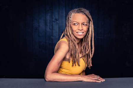 Portrait of a smiling African American Woman with dreadlocks looking left Foto de archivo