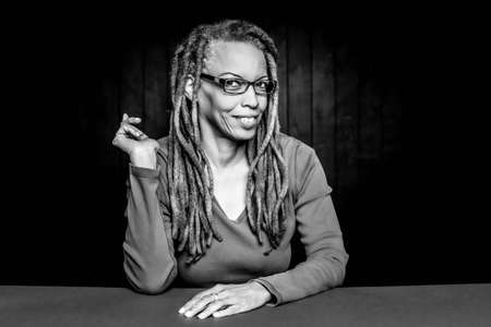Black and white portrait of an attractive African American Woman with dreadlocks