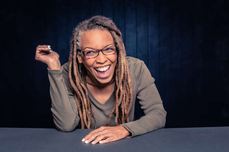 Portrait of a laughing African American Woman with dreadlocks Foto de archivo - 144205588
