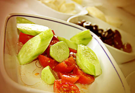 greek food: tomatoes salad on the table as a breakfast