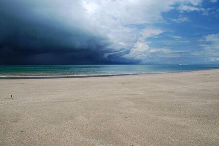 upcoming: Upcoming thunderstorm at beach Stock Photo