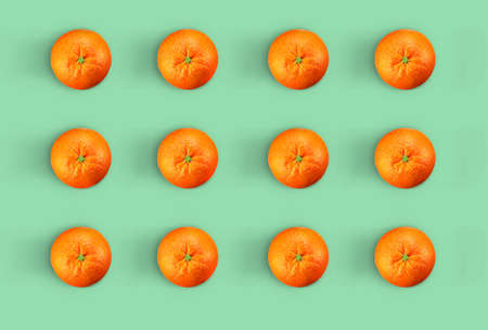 Creative oranges pattern. Minimal vitamin c orange concept. Orange in color background Foto de archivo - 122306028