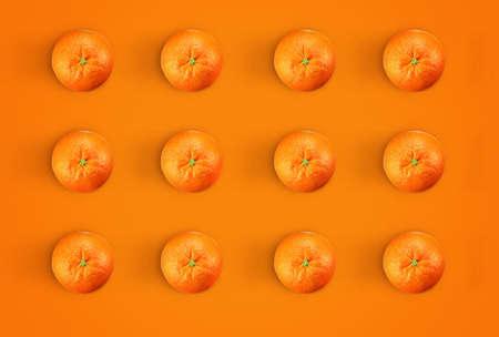 Orange pattern. Creative Minimal oranges concept. fresh oranges in orange background