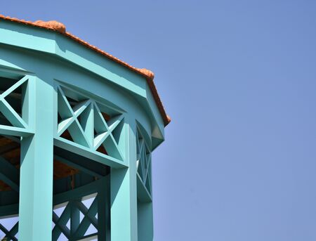 Turquoise Classic Wooden Building against blue sky.