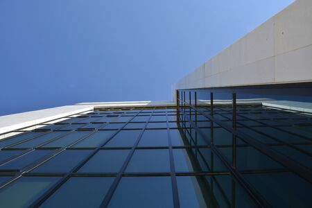 A glass business building with blue sky on the background 版權商用圖片
