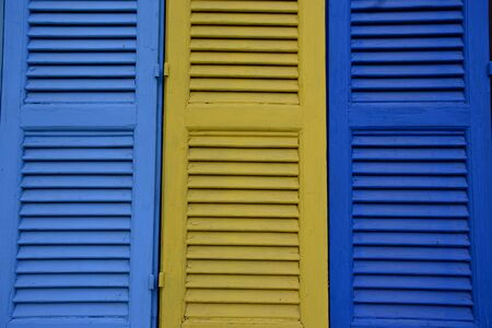 Photo of brightly rustic multicoloured wooden vintage external windows