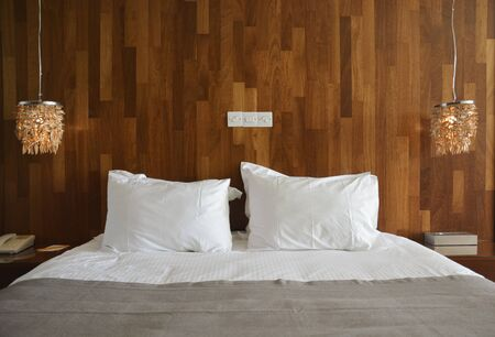 Luxury Hotel Bed with White Sheets and Pillows
