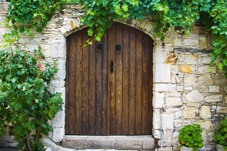 Stone Built Home with a Wooden Rustic Door
