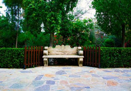 A Stone Built Bench in a Beautiful Green Garden
