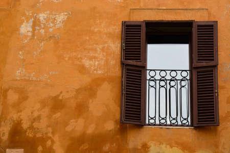A Vintage Window with Rustic Orange Wall 版權商用圖片
