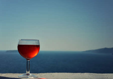 Glass of Red Wine with the Aegean Sea in the Background
