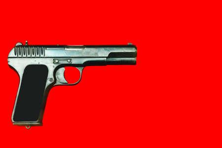 WWII German army handgun on red background.