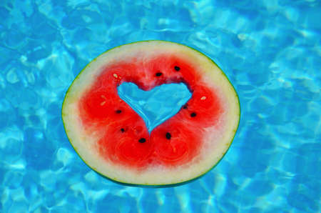 A heart shaped watermelon, floating in the blue waters of the Mediterranean Sea.