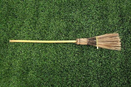 slovenly: Broom on green grass  Stock Photo