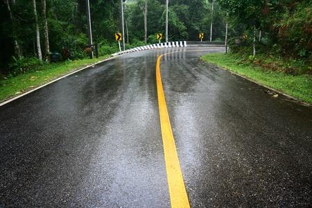 slippery: wet road  Stock Photo