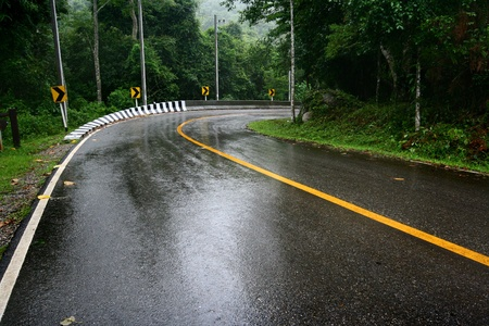 lonely road: wet road  Stock Photo