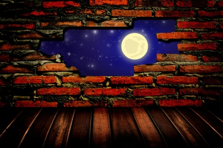 moon and star through the hole in the brick wall  photo
