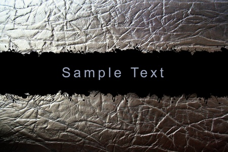 burned: abstract leather upholstery texture with sample text area