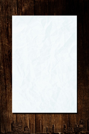 white crumpled paper with line on wood background  photo