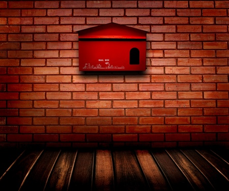 mail box on brick wall and wooden floor  photo