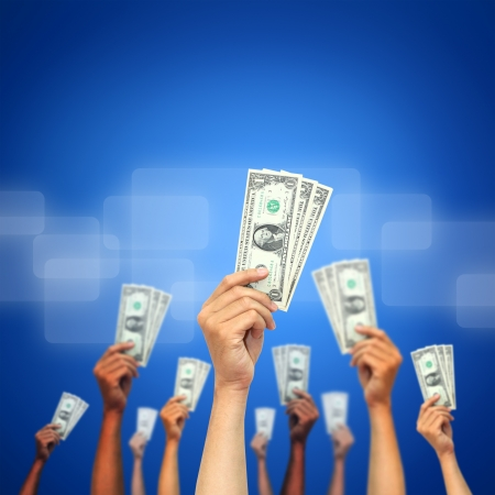 win money: money in many hands Stock Photo