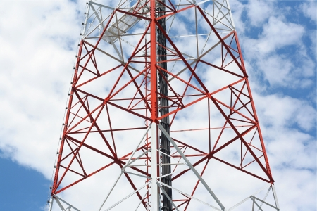 Telecommunications tower and blue sky photo