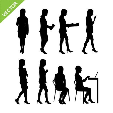 business attire teacher: Business woman silhouettes vector
