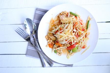 somtum: Top view Papaya salad on white background