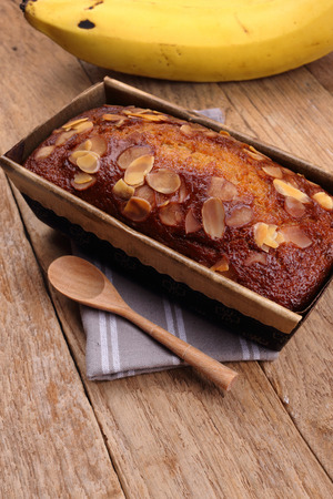 chocolate cake: banana cake on wooden background