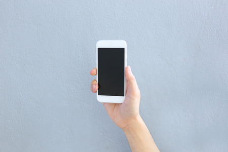 hand phone: Hand holding smartphone with blank screen