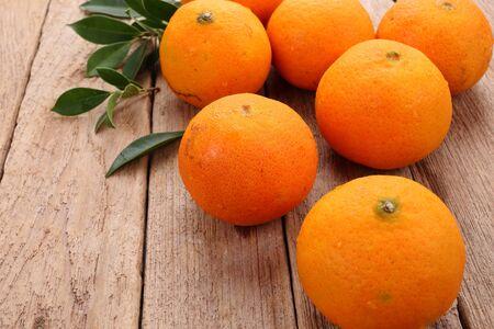 Ornage fruit on wooden background Stock Photo