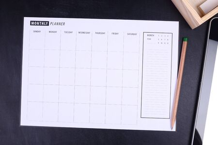 electronic organiser: Monthly planner with pencil and tablet