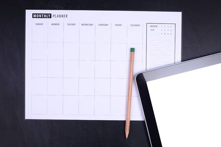Monthly planner with pencil and tablet