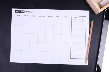 background calendar: Monthly planner with pencil and tablet