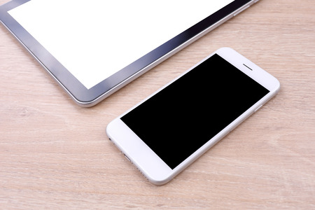 blank tablet: Perspective smartphone and tablet blank screen on wooden background