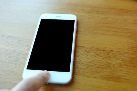 hand press: Hand press on home button of smartphone