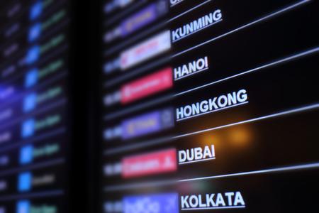 kunming: Flight board background of Kunming, Hanoi, Hongkong, Dubai, Kolkata Stock Photo