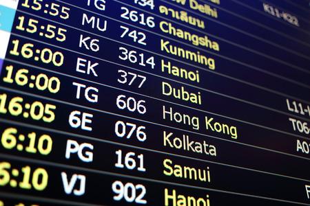 cronogramas: Flight board background of Changsha, Khunming, Hanoi, Dubai, Hongkong, Kolkata, Samui Foto de archivo