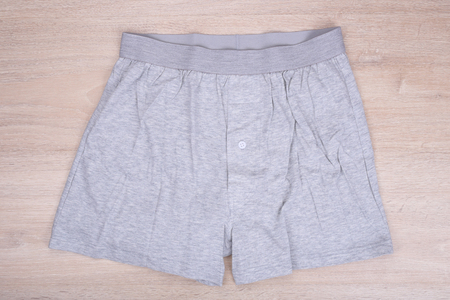 boxer shorts: Men gray boxer shorts on wooden background Stock Photo