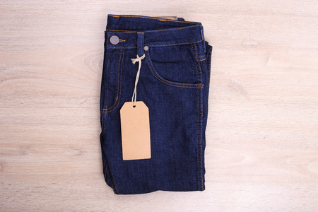 navy blue background: Blue navy jean with label on wooden background
