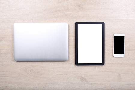 computer devices: Laptop computer with mockup tablet and smartphone devices on wooden background