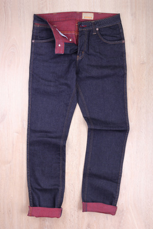 navy blue background: Dark blue jeans on wooden background Stock Photo