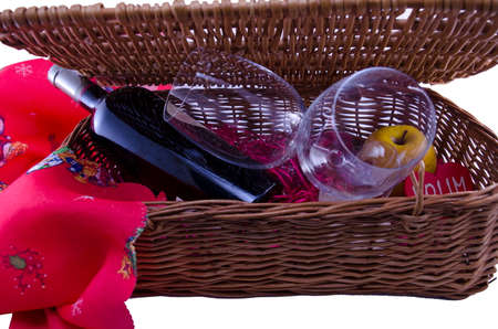 A bottle of wine and a couple of  glasses in a wooden  picnic box photo