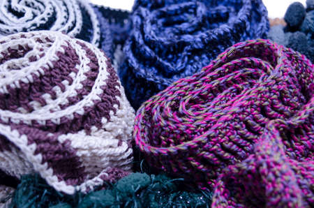 put together: A bunch of handmade colorful scarfs put together in a closeup