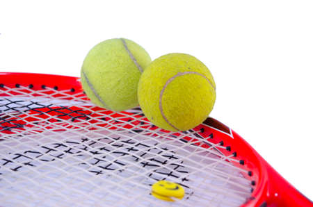raquet: Tennis racket with two tennis balls isolated on white background Stock Photo