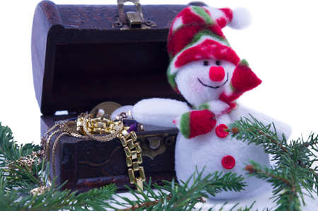 toy chest: Snowman and a treassure chest full with jewelry isolate on white background